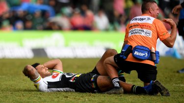 Early casualty: Viliame Kikau goes down in just the third minute of the match.
