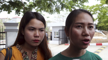 Pan Ei Mon, right, wife of Reuters journalist Wa Lone, talks to journalists as she leaves the Supreme Court along with Chit Su Win, left, wife of Reuters journalist Kyaw Soe Oo, on Tuesday.