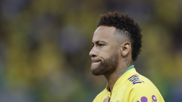 Brazil's Neymar during the national anthem, prior a friendly soccer match against Qatar at the Estadio Nacional in Brasilia on Wednesday.