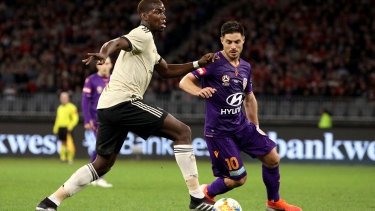 Paul Pogba of Manchester United and Bruno Fornaroli of the Glory in action at Optus Stadium.