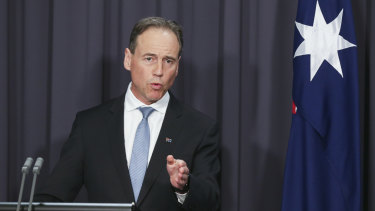 Health Minister Greg Hunt says Victoria's daily new cases are what should dictate easing restrictions.