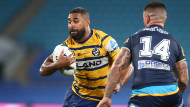 Michael Jennings of the Eels takes on the Titans defence in Parramatta's victory on Sunday.