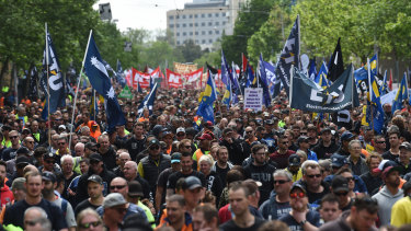 Thousands of people gather for a union rally through the streets of Melbourne on Tuesday.
