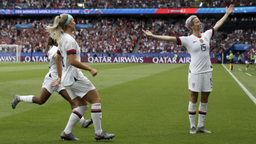 Megan Rapinoe, right, celebrates after scoring the US' first goal against France in the World Cup quarter finals.