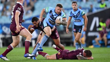 Jake Friend on the ground after a big collision with Nathan Brown in Origin II.
