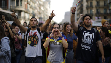 Protestors shout slogans in Barcelona, Spain over sentences handed down to Catalan separatists.
