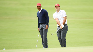 Tiger Woods with under-fire star Patrick Reed.
