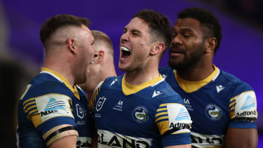 Mitchell Moses screams to Eels fans after scoring at Bankwest Stadium.