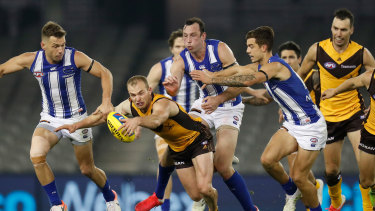 Hunting in packs: Congestion around the footy has become a more common feature over past years, says the Hawks coach.