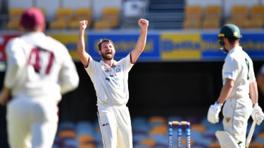 Michael Neser (centre)of the Bulls celebrates the wicket of Jake Doran.
