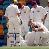 Andy Bichel of Queensland cradles Justin Langer of Western Australia in his arms after Langer was hit in the head by a bouncer bowled by Bichel during the Pura Cup cricket match between Queensland and Western Australia in 2001.