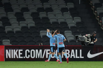 Sydney goalscorer Adam Le Fondre applauds to the empty stand at Bankwest Stadium.