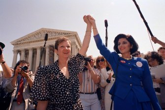 Norma McCorvey, Jane Roe in the 1973 court case, (left) and her attorney Gloria Allred hold hands outside the Supreme Court in Washington in 1989.