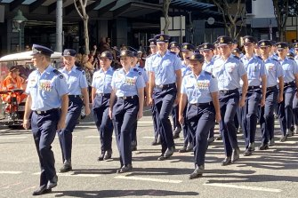 RAAF squadrons march along George Street during their centenary year.