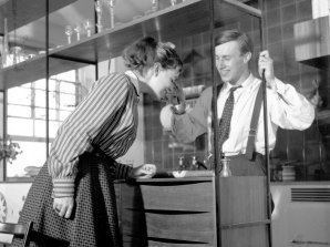 Designer Terence Conran, and his wfe Shirley looking at a new shelving design, 1955.