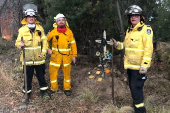 Three members of the Hawkesbury RFS brigade, Matthew Shepherd, Jared Robinson and Ben Vilnis, were creating a space around a memorial for a dead motorcyclist.