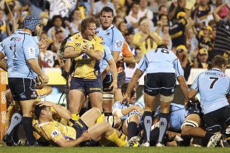Dan Palmer celebrates a try in 2013 during his time at the Brumbies.