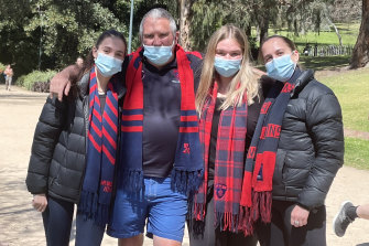 Demons fan Mike McShane and his daughters Georgia, Zoe and Emma took to the Tan in South Yarra.