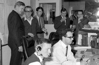 Prime minister John Gorton (left) visits the Honeysuckle Creek Tracking Station on the morning of July 21, 1969. Seated is John Saxon and Ian Grant. Next to Gorton is station director Tom Reid.