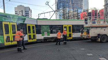 Derailed tram on the intersection of Flinders and Spencer streets.