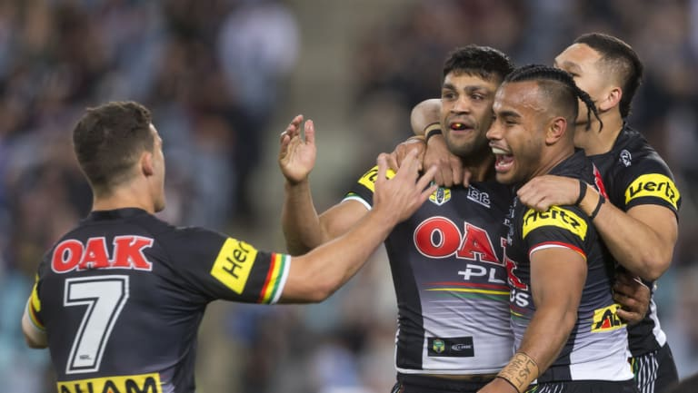 Key man: The Panthers celebrate a Tyrone Peachey try against the Warriors on Saturday.