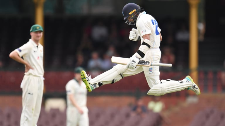 Young runs: Jason Sangha leaps in celebration after reaching his century against Tasmania.