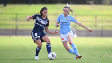 Victory's Angela Beard and City's Rhali Dobson play at Epping on Saturday, with the surface having been roundly condemned.