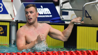 Pretty special: Kyle Chalmers checks out the clock after winning the 100m freestyle.