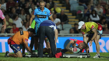 Tariq Sims breaks his leg while playing against Penrith for the Cowboys in 2011.