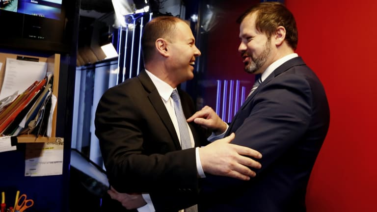 Environment and Energy Minister Josh Frydenberg crosses paths with Labor MP Ed Husic outside the Sky News studio at Parliament House in Canberra in 2017.