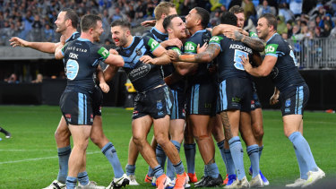 Blues players celebrate the try of Josh Addo-Carr during Game 2 of the 2019 State of Origin series.