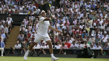 Roger Federer returns the ball to Japan's Kei Nishikori during their quarter-final match.
