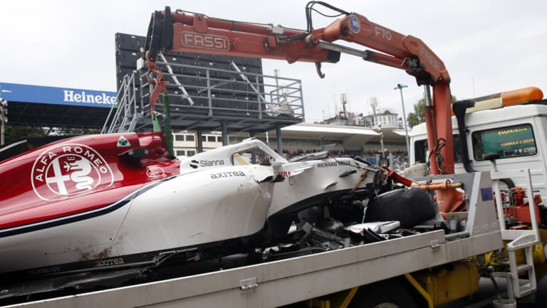 Write-off: The car of Sauber driver Marcus Ericsson of Sweden is carried away by a truck.