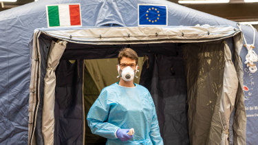 A medical worker at a pre-triage centre in Turin, Italy.