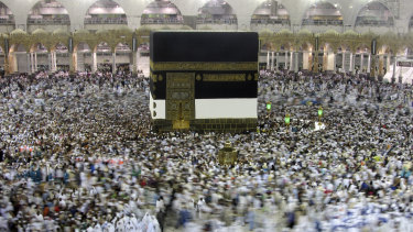 Muslim pilgrims pass around the Kaaba, at the Grand Mosque, ahead of the Hajj pilgrimage in the Muslim holy city of Mecca, Saudi Arabia. Saudi Arabia halted travel to the holiest sites in Islam over fears of the global outbreak of the new coronavirus.