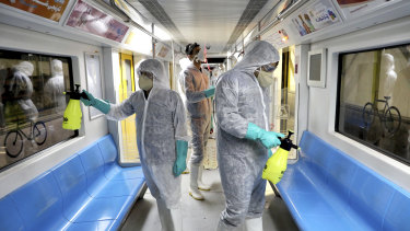 Health workers disinfect subway trains against coronavirus in Tehran, Iran.