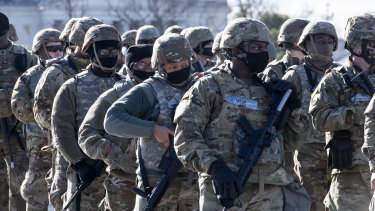 Members of the National Guard arrive at the US Capitol Visitor Centre for a security threat during a dress rehearsal ahead of Inauguration Day.