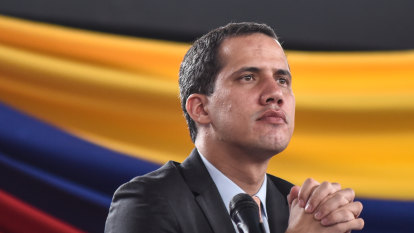 Venezuela's Juan Guaido defies travel ban to woo support abroad