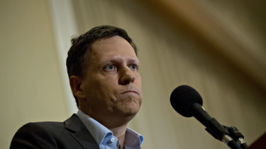Peter Thiel, co-founder of PayPal Inc., pauses while speaking during a news conference at the National Press Club in Washington, D.C., U.S., on Monday, Oct. 31, 2016.