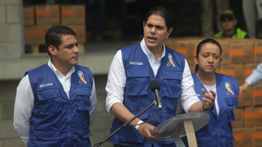 Lester Toledo, an ally of Venezuelan National Assembly leader Juan Guaido, centre, speaks as US humanitarian aid is packaged at a warehouse in Cucuta.