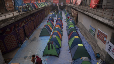 Donated tents to shelter women line the floor of a vacant commercial complex in New Delhi. Protesters have created camps around Delhi that are virtual cities unto themselves, using donations and their own organisational skills in their battle against new government farm policies.