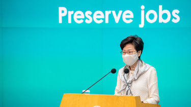 Carrie Lam, Hong Kong's Chief Executive, speaks while wearing a protective mask during a news conference in Hong Kong.