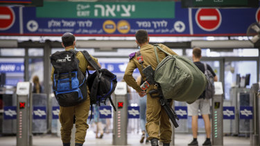 Prospects for violence: Israeli soldiers at  Hashalom train station in Tel Aviv.