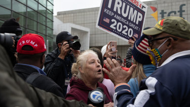 Trump supporters clash with a counter demonstration in Detroit, Michigan.