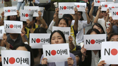 "Protesters stage a rally in front of the Japanese embassy in Seoul, South Korea denouncing the Japanese government's decision on their exports to South Korea. The signs read: ""No (Japanese PM) Abe."""