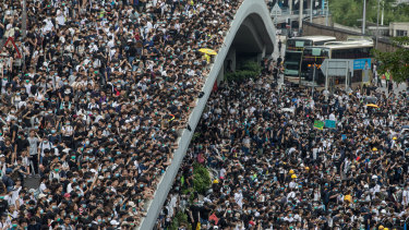 Protesters occupy a main road and walkways during a rally against a proposed extradition law in Hong Kong, China.