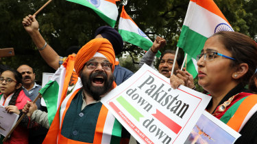 National Akali Dal leaders shout slogans in New Delhi as they celebrate the Indian Airforce bombing Pakistan territory on Tuesday, February 26.