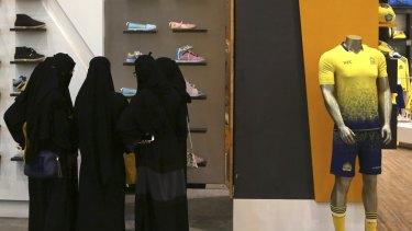 Saudi women shop at a mall in Riyadh.
