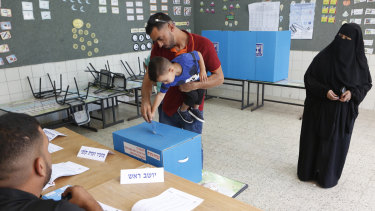 Israeli bedouin arabs cast their votes in a polling station in the city of Rahat, Israel.