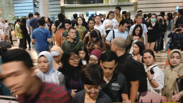 People leave a shopping mall following an earthquake in Jakarta.